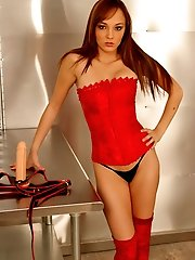 Stunning babe in red straps on a dildo